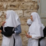 Nun's entering the Church of the Holy Sepulchre