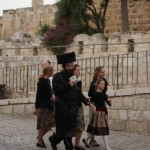 Jewish family reading Torah as they return from the Western Wall